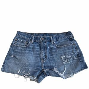 LEVIS 559 High Rise distressed cut off Jean shorts